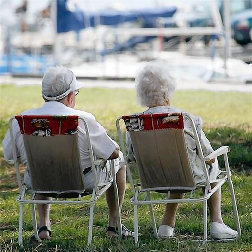 Seniors relax by the sea in Andernos, Southwestern France