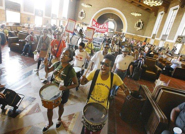 About 200 protesters march through Union Station in downtown L.A. demanding more community involvement in Metro's management and development of property along transit lines. A key concern among demonstrators was affordable housing.