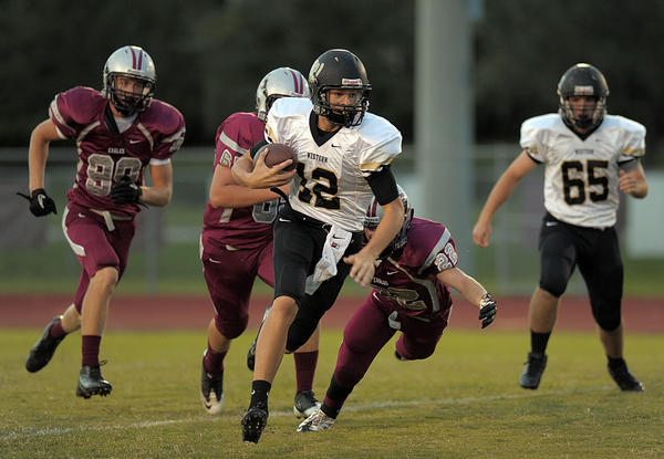 Western quarterback Wade Freebeck runs past the Douglas defense for a first down during the first half.