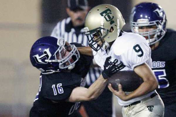 Hoover's Brendon Kerr tackles a Temple City ball carrier.