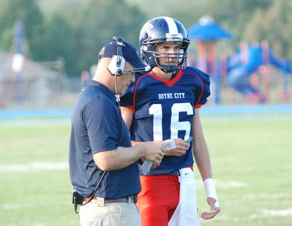 Coach Dave Hills (left) and sophomore quarterback Cory Redman lead unbeaten Boyne City into a big Lake Michigan Conference today, Friday, at Harbor Springs. The Rams are 2-1.