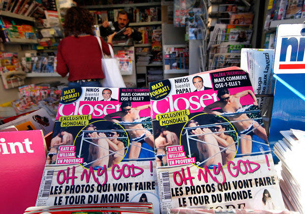 Copies of French magazine Closer showing pictures of Catherine, Duchess of Cambridge, and Britain's Prince William are displayed in a newspaper kiosk in Nice, September 14, 2012.