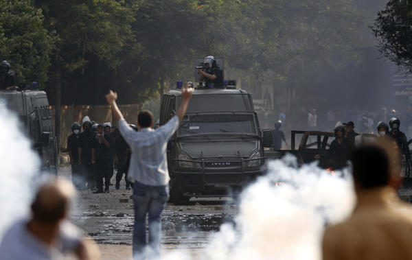 Egyptian protesters clash with riot police near the U.S. embassy in Cairo, Egypt, Thursday. Protesters clashed with police near the U.S. Embassy in Cairo for the third day in a row. Egypt's Islamist President Mohammed Morsi vowed to protect foreign embassies in Cairo, where police were using tear gas to disperse protesters at the U.S. mission.