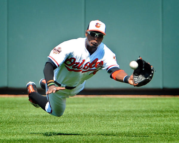 Orioles center-fielder Adam Jones makes a diving catch of a sacrifice fly ball by the Rays' Jeff Keppinger in the 4th inning.  Rays' Ben Zobrist scored on the play. The Orioles defeated the Rays by score of 3 to 2 in 14 innings.