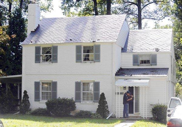 An Insurance restoration contractor worker is pictured at the house at 800 Olmstead Road in Pikesville where the elderly couple Vaughn George Pepper, 87, and Marjorie Marie Pepper, 85, were found dead. Baltimore County Police are investigating their deaths as homicides.