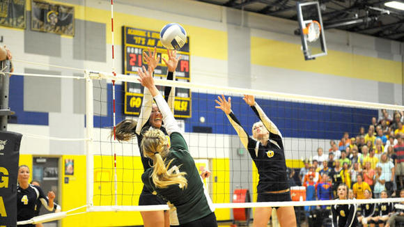 The Gaylord tandem of Dakota Pelach (left) and Brooke Stier converge for an attempted block during the Blue Devils' three-game loss to Alpena Wednesday.