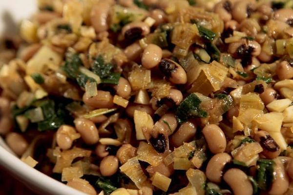 "Black-eyed peas with leeks and chard. <a href=""http://www.latimes.com/features/food/la-fo-rosh-hashanah-rec1-20120915,0,4056322.story"">Recipe</a>"