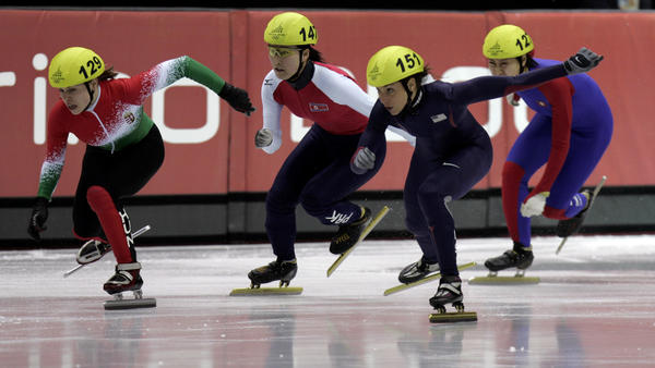Allison Baver (second from right) competes during the 2006 Winter Olympics.