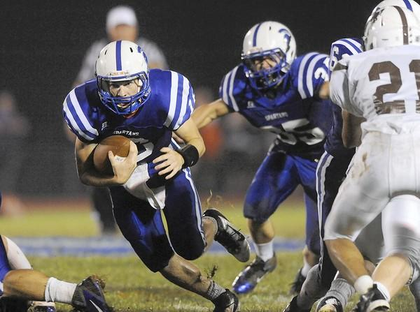 Southern Lehigh QB Travis Edmond (left) looks for room to run in the second quarter against Catasauqua High School.