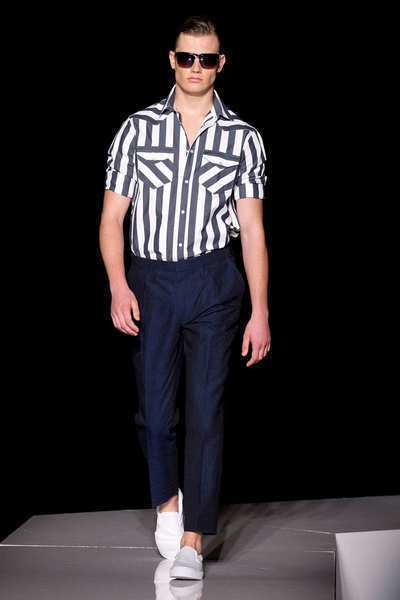 Bold stripes emerged as the predominant graphic element for spring during the shows, which ended Thursday. Michael Bastian showed workwear-inspired, railroad-striped denim pullover shirt jackets, five-pocket jeans and slouchy Confederate soldier style kepi hats (the latter a collaboration with Mr. Kim, Eugenia Kim's men's line). Michael Kors employed horizontal rugby stripes on men's pullover shirts and vertical, referee-like stripes on cotton blazers. The latter look also cropped up on Western-style shirts in the Joseph Abboud collection. Pictured is a look from the Joseph Abboud collection.