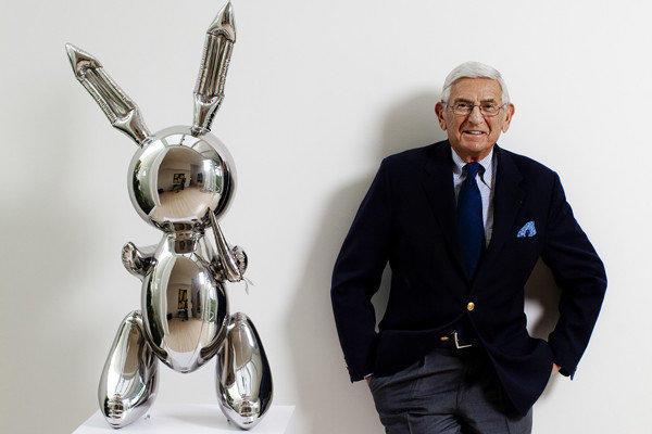 """Eli Broad is pictured in his home with a stainless steel work by Jeff Koons called """"Rabbit."""""""