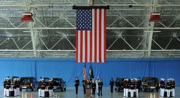 At Andrews Air Force Base in Maryland, President Obama, center, speaks during a ceremony marking the return to the U.S. of the remains of the four Americans killed in an attack on the U.S. consulate in Benghazi, Libya. Ambassador J. Christopher Stevens died along with three other Americans in the assault on the consular building on the 11th anniversary of the Sept. 11 attacks.