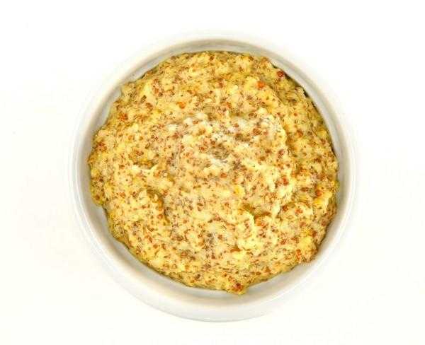 "Why buy mustard when you can make your own? This hard cider mustard -- a coarse mustard dotted with bits of tart fresh apple -- is easy to make, and nothing beats the flavor of homemade. <a href=""http://www.latimes.com/features/food/la-fo-mustardrec3-20111124,0,940514.story"">Click here for the recipe.</a>"