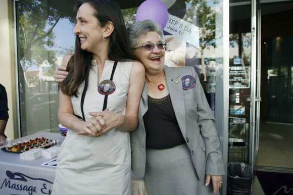 Helen McDonagh, owner of Massage Envy, receives a hug from the former executive director of Glendale Healthy Kids during a 'mayoral' campaign event in Glendale on May 31, 2012.