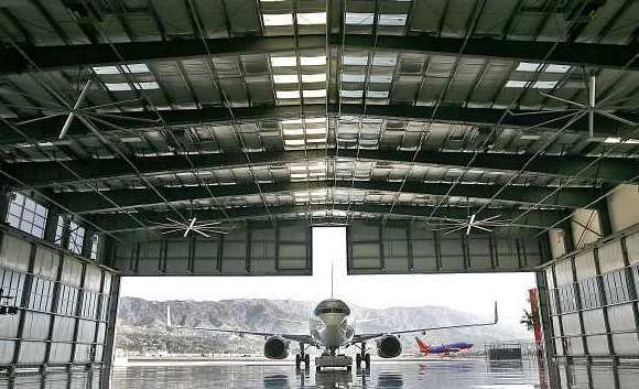 A private jet is taxied into the newly opened hangar at the Bob Hope Airport .
