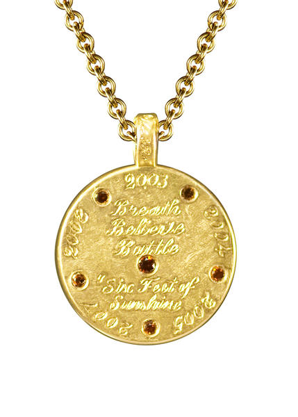 Custom 18-karat gold amulet worn by Kerri Walsh Jennings in the 2012 London Olympics; Me&Ro, www.meandrojewelry.com