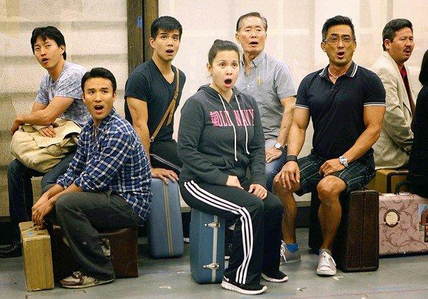 "The ensemble of ""Allegiance"" rehearses at the Old Globe Theater rehearsal hall in San Diego. Together in the middle are the three lead actors: Telly Leung, left, Lea Salonga and George Takei."