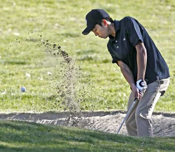 Crescenta Valley High School's Paul Park chips out of the sand trap during play in the 48th Annual Burbank High Schools Invitational at DeBell Golf Club in March.
