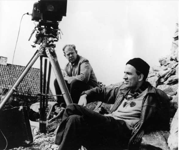 "The seminal Swedish filmmaker,  Ingmar Bergman, right, relaxes while on location on the islet of Faro off Gotland Island in the Baltic Sea for his Oscar-winning drama ""Through a Glass Darkly"" in 1960. At left is his longtime  cinematographer  Sven Nyqvist."