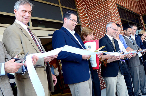 Cutting the ribbon at Parkway Professional Center Friday afternoon are, from left, Dr Dan Sullivan, MD, Senator Chris Shank, Dr. Roberta Rothen, and Dr. Thomas Larkin.