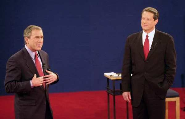 Vice President Al Gore, right, was surging in the polls in September 2000, but his performance in debates with George W. Bush didn't win him many votes. Here he debates Bush on Oct. 17, 2000, in St. Louis.