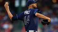 The Tampa Bay Rays woke up at the plate in the fifth inning of Friday night's series opener against the Yankees in New York, scoring three times to hand pitching ace David Price a two-run lead in his showdown with CC Sabathia.