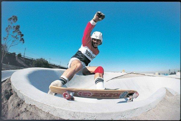 Tom Sims, a skateboarding and snowboarding pioneer, rides one of his company's skateboards.