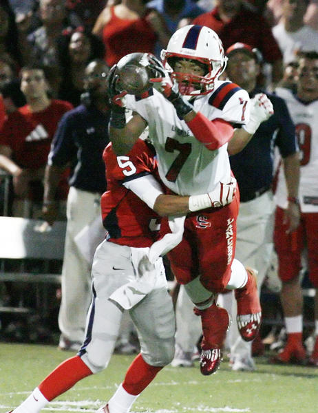 La Salle's Jalen Gray had to leap then dive to make a catch against Maranatha's Darron McWhorter.