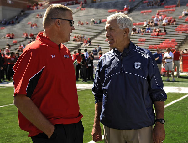 Maryland head coach Randy Edsall and UConn head coach Paul Pasqualoni greet one another before their game at Capital One Field at Byrd Stadium Saturday afternoon. Edsall was the former coach of the Huskies.