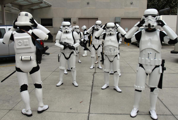 Star Wars 501st legion prepare to march into the Orange County Regional History Center during Galactic Encounter Day in Orlando, Fla.