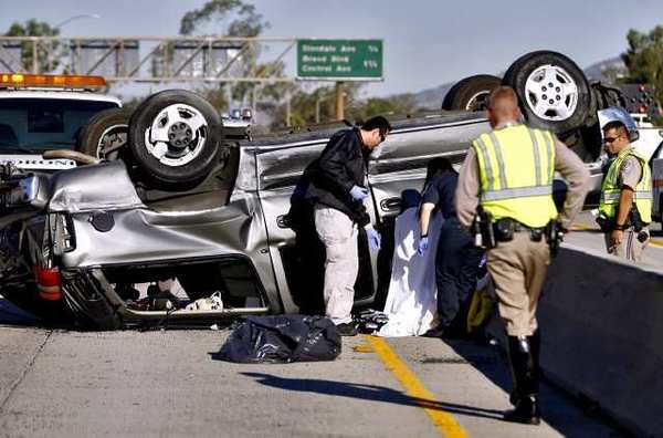 L.A. County Coroner's officials and California Highway Patrol officers investigate a fatal accident on the 134 Freeway west of the 2 Freeway in Glendale on Friday morning, Sept. 14, 2012. Traffic was snarled on both sides of the freeway.