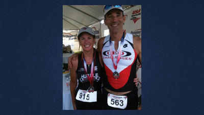 Ann Cutrell and Guy Berkebile are all smiles after completing a triathlon.
