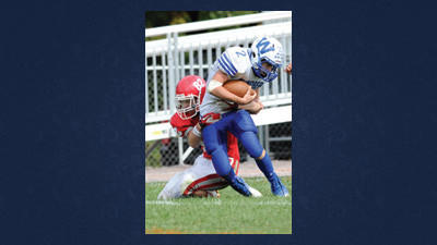 Windber's Devon Tomlinson is brought down by Rockwood's Matt May Saturday.