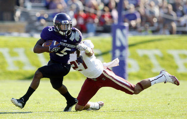 Northwestern running back Venric Mark is tackled by Boston College's Justin Simmons during the second quarter.