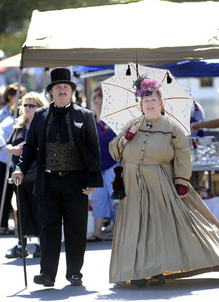 Stephanie and Orion Taylor take to the streets of Sharpsburg in their period clothes at the annual Sharpsburg Heritage Festival on Saturday.