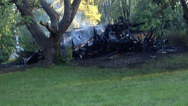 The remains of a Warrenville home where a man was rescued by neighbors this morning.