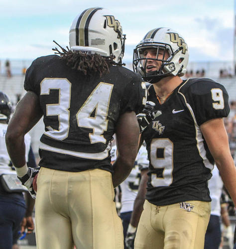 University of Central Florida's Brynn Harvey (34) and J.J. Worton (9) celebrate after scoring during fourth quarter action of a C-USA football game against Florida International University at the Brighthouse Networks Stadium on Saturday, September 15, 2012 in Orlando, FL.