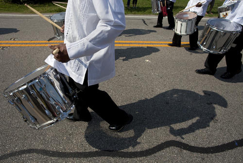 Members of the First Panamanian Marching Band of Maryland march during the Denbigh Day Parade on Saturday.