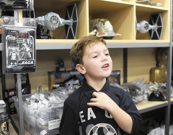 Eli Schaadt, 6, of Emmaus, has collected Star Wars figures his whole life. He and his family now sell such collectibles at The Cash Cow, their stall in Black Rose Antiques & Collectibles at the South Mall.