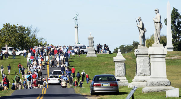 A very large group walks the Antietam National Battlefield near the Cornfield on Saturday.