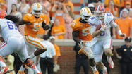 KNOXVILLE, Tenn. - Behind their quarterback of the future, Jeff Driskel, and a quarterback from their past, do-everything junior Trey Burton, the Florida Gators staged another dramatic, second-half comeback on the road.