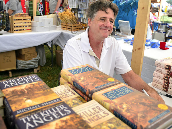 New York Times bestselling author, Jeff Shaara signs copies of his books at the Antietam 150th Anniversary re-enactment site Saturday.