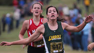 The Bishop Carroll girls and Wichita North boys took top honors at the Wichita Southeast Invitational Cross Country Meet Saturday during a cool and cloudy morning.