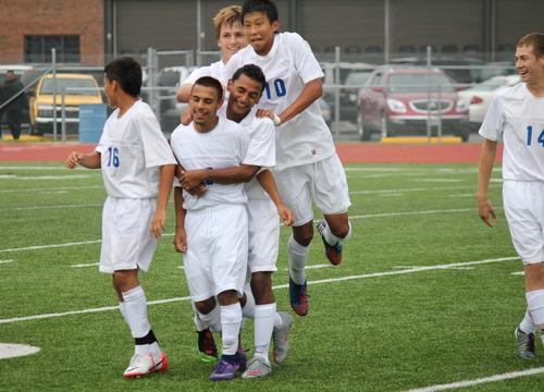 Goals by Nick Cho and Abel Madrigal lifted Wichita East to a 2-1 double overtime victory over Trinity Academy.