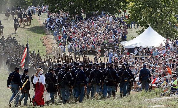Union soldiers walk past crowd gathered to see Saturday's re-enactment of Bloody Lane.