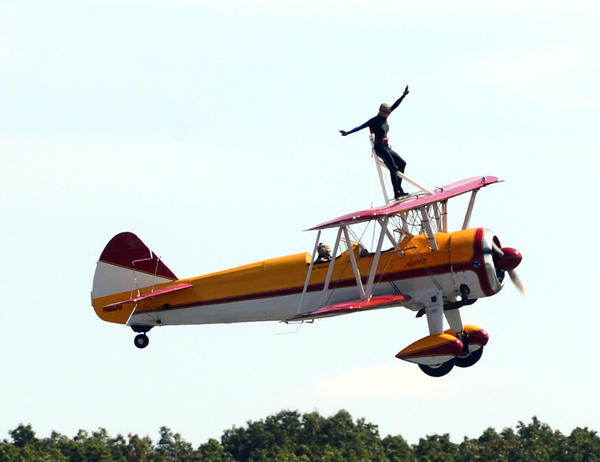 Wing walker Jane Wicker performing at this year's Thunder Over The Blue Ridge Air Show in Martinsburg on Saturday.