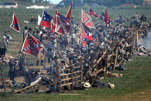 Confederate infantry re-enactors participate in the Battle of Bloody Lane during an event to mark the 150th anniversary of the Battle of Antietam.