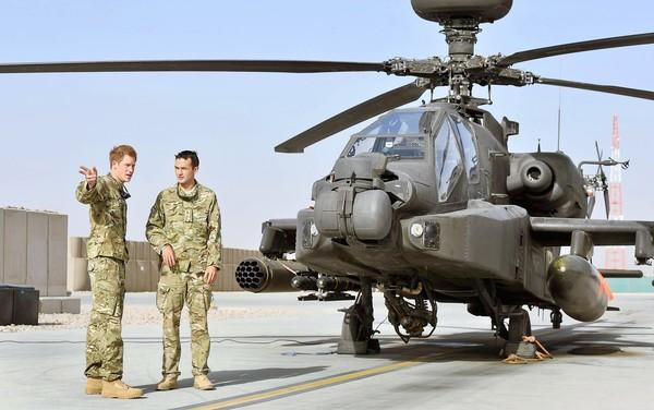 The Taliban chose the NATO base Camp Bastion in Helmand province to attack because Britain's Prince Harry, left, is stationed there, a Taliban spokesman said. The Apache helicopter pilot is known in the military as Capt. Harry Wales.