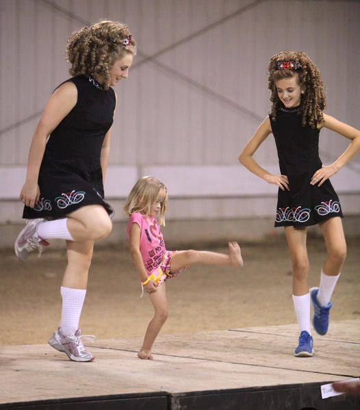 Makayla Habedank, 5, of Aberdeen, center, tries to high-step along with Katy Gorrilla, left, and Olivia Alberts of the Rince na Chroi Irish Dancers of St. Paul, Minn., during an Irish Step Dance workshop Saturday at the Northeast South Dakota Celtic Faire and Games on the Brown County Fairgrounds.