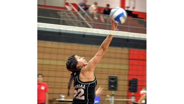Imperial Valley College's Sasha Cota tries to spike in a volleyball match at IVC's round-robin tournament at IVC on Saturday.